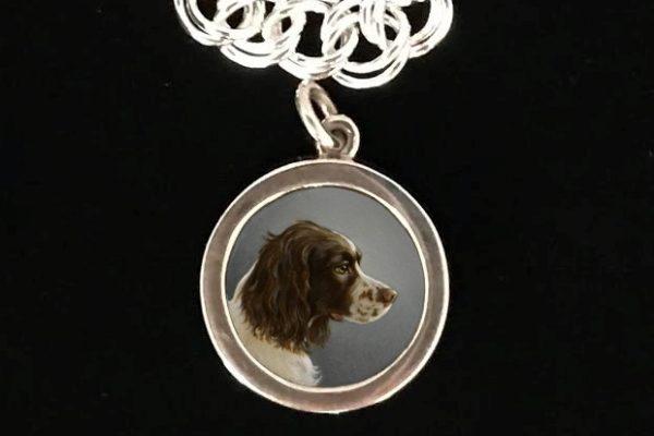 silver dog charm and bracelet